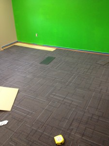 Carpet being installed in large conference room